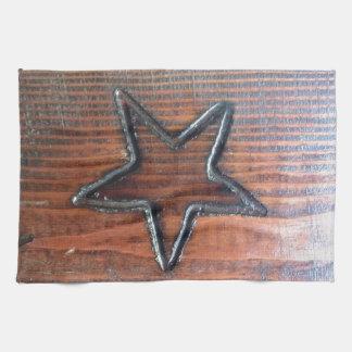 La estrella rústica quemó en el pirograbado de mad toallas de mano