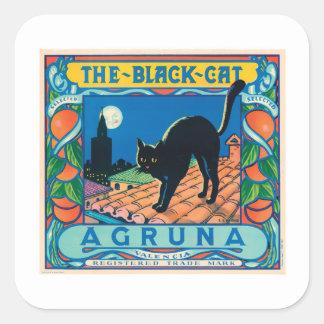 La etiqueta anaranjada del vintage del gato negro