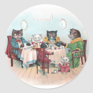 La familia de gato se sienta para desayunar pegatina redonda