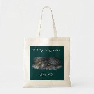La fauna de los ojos del lobo gris lleva el bolso bolsa