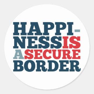 La felicidad es una frontera segura pegatina redonda