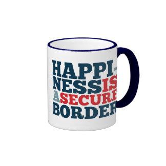 La felicidad es una frontera segura tazas
