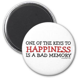 La felicidad es una mala memoria imán redondo 5 cm