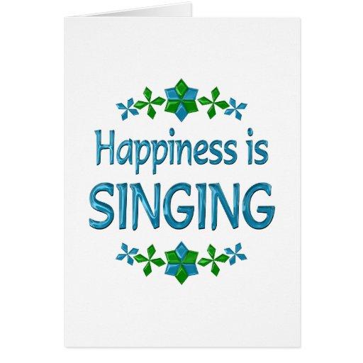 La felicidad está cantando tarjeta de felicitación