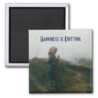 La felicidad está haciendo punto la pintura de un imán cuadrado
