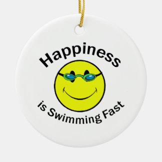 La felicidad está nadando rápidamente adorno navideño redondo de cerámica