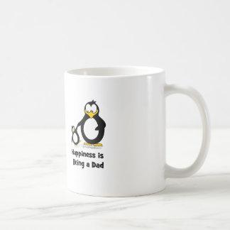 La felicidad está siendo un pingüino del papá tazas de café
