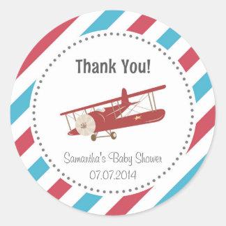 La fiesta de bienvenida al bebé del aeroplano le pegatina redonda