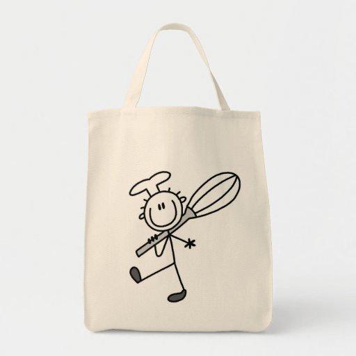 La figura cocinero del palillo con bate bolsas de mano