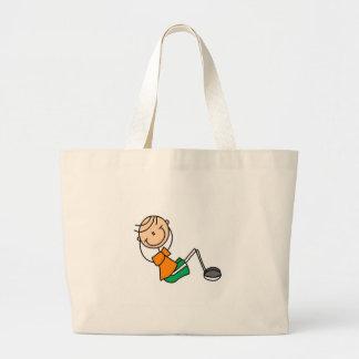 La figura del palillo se sienta sube el bolso bolsa de tela grande