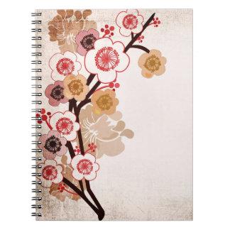 La flor de cerezo del vintage florece el cuaderno