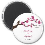 La flor de cerezo y el pájaro elegantes ahorran la iman para frigorífico