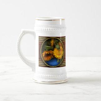 La flor - girasol - los soles ha subido jarra de cerveza