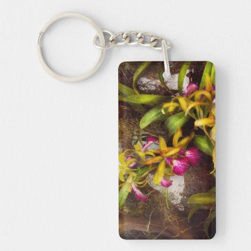 La flor - orquídea - allí es algo sobre orquídeas llavero rectangular acrílico a doble cara