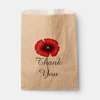 La flor roja de la amapola le agradece favorecer bolsas de recuerdo