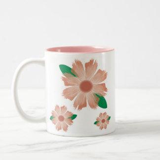 La flor zurda se descolora taza de la escritura -