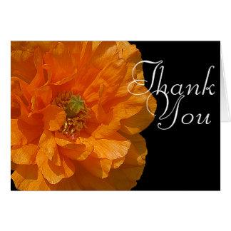 La foto anaranjada de la flor de la amapola de tarjeta pequeña