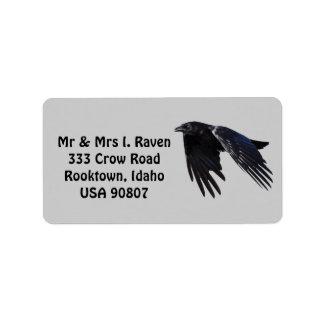 La foto negra del cuervo que vuela etiqueta 6 etiquetas de dirección