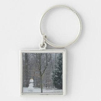 La fotografía de la nieve del invierno del muñeco llavero cuadrado plateado