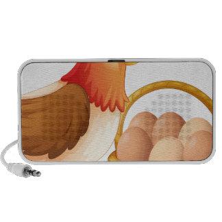 La gallina de la madre y una cesta de huevos portátil altavoz