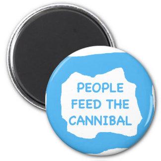 La gente alimenta al caníbal .png imán redondo 5 cm