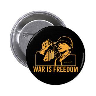 La guerra es botón de la libertad pins