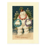 La guirnalda adornó el muñeco de nieve postales