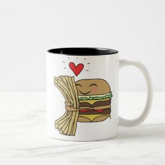 La hamburguesa ama las fritadas taza de dos tonos