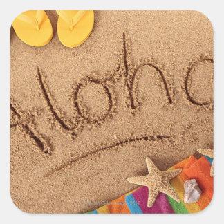La hawaiana de la palabra escrita en una playa are colcomanias cuadradas