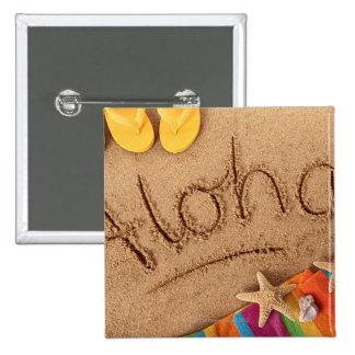 La hawaiana de la palabra escrita en una playa are pin cuadrado