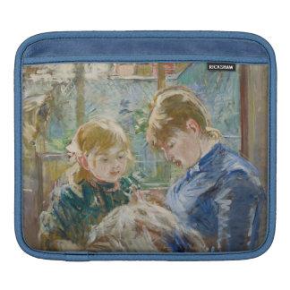 La hija del artista, Julia, con su niñera Manga De iPad