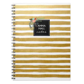 La hoja floral y de oro moderna raya el cuaderno