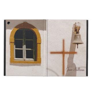 La iglesia griega con el iPad de la cruz y de Bell