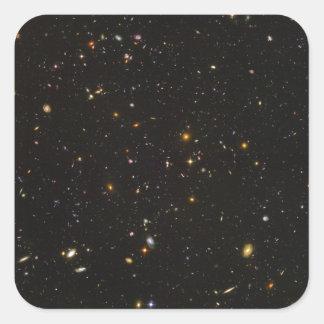La imagen ultra profunda del espacio del campo de pegatina cuadrada