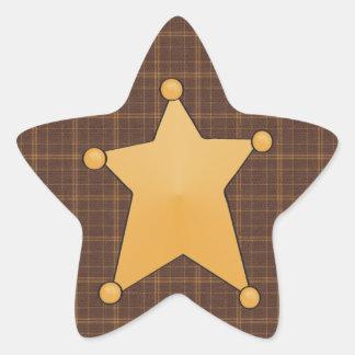 La insignia del sheriff de oro de la estrella