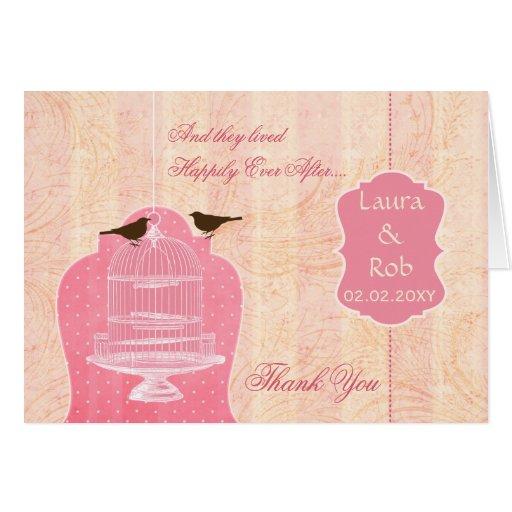 La jaula de pájaros rosada elegante, pájaros del tarjeta de felicitación