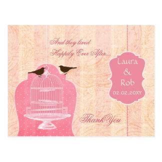 La jaula de pájaros rosada elegante pájaros del postal