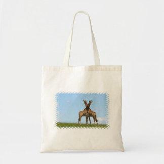 La jirafa hermana la pequeña bolsa de asas