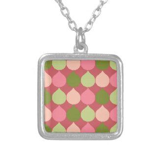 La lágrima geométrica verde rosada de Ikat Joyería
