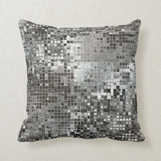 La lentejuela de plata deslumbra la almohada atrac