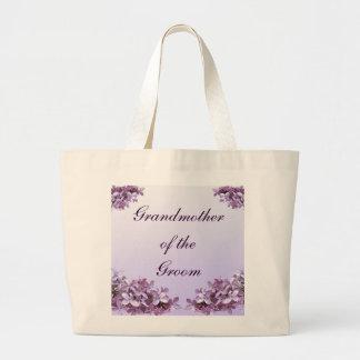 La lila floral florece a la abuela del boda del bolsa tela grande