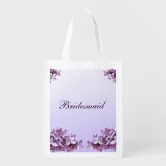 La lila floral florece a la dama de honor del boda bolsas para la compra
