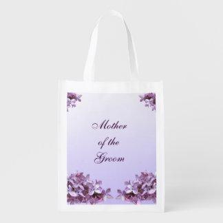 La lila floral florece a la madre del boda del bolsas para la compra