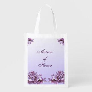 La lila floral florece a la matrona del boda del bolsas para la compra