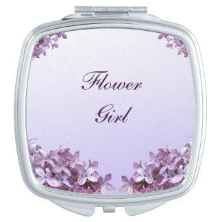 La lila floral florece al florista del boda espejo de maquillaje