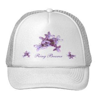 La lila floral florece el portador del anillo de gorro