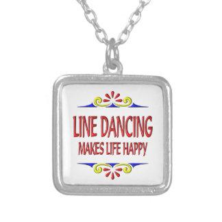 La línea baile hace vida feliz colgantes