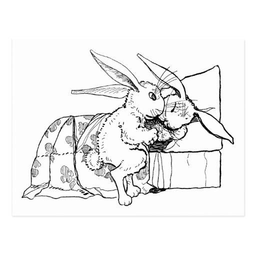La mamá pone el conejo joven para acostar tarjeta postal