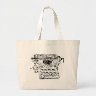 La máquina de escribir redacta el bolso bolsas de mano