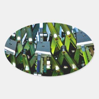La máquina verde pegatina ovalada